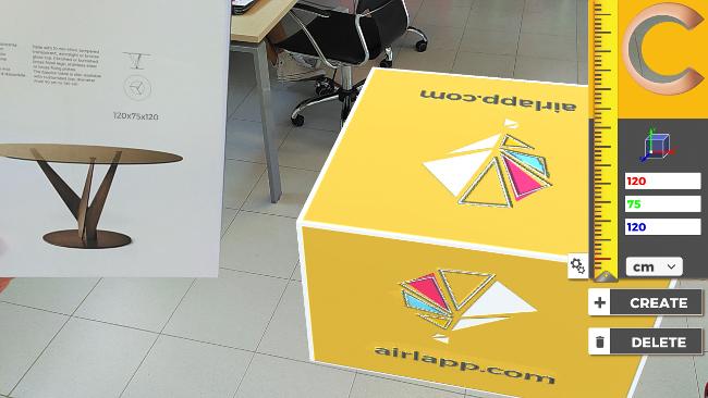 App Cubeter che mostra un cubo 3D in realtà aumentata delle dimensioni di un tavolo per lo studio dell'ingombro